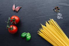 Pasta ingredients on black slate background Royalty Free Stock Photography