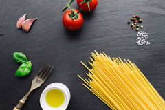 Pasta ingredients on black slate background. Viewed from the top stock photos