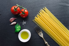 Pasta ingredients on black slate background. Viewed from the top Royalty Free Stock Photos
