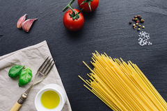Pasta ingredients on black slate background. Viewed from the top Royalty Free Stock Images