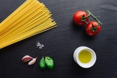 Pasta ingredients on black slate background Stock Images
