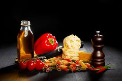 Pasta ingredients on black table Royalty Free Stock Images