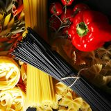 Pasta ingredients on black table Stock Photo
