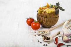 Pasta and ingredients: chili, tomatoes, basil, garlic and parsle Royalty Free Stock Images