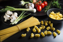 Pasta with ingredients Stock Photography