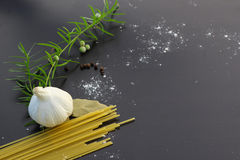 Pasta ingredients concept. On black slate background viewed from the top Royalty Free Stock Image