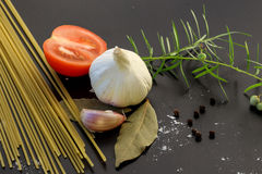Pasta ingredients concept. On black slate background viewed from the top Royalty Free Stock Photography