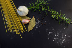 Pasta ingredients concept. On black slate background viewed from the top Royalty Free Stock Photos