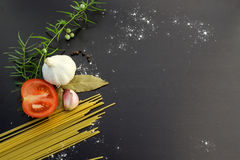 Pasta ingredients concept. On black slate background viewed from the top Stock Photo