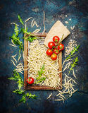Pasta with ingredients for cooking on rustic background, top view. Royalty Free Stock Photography