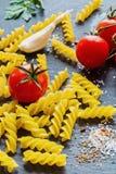 Pasta ingredients (fusilli). On black slate background Royalty Free Stock Photography