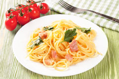 Pasta ingredients on green background. Royalty Free Stock Photo