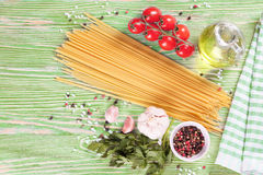 Pasta ingredients on green background. Stock Photography