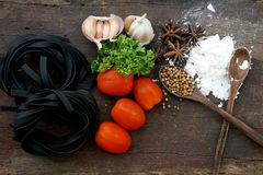 Pasta with ingredients like flour, tomato, garlic and pepper Stock Images