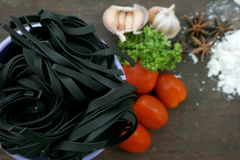 Pasta with ingredients like flour, tomato, garlic and pepper Stock Photo