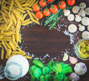 Pasta ingredients:penne, mushrooms, a jug of cream, olive oil, g Stock Photography