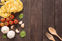Pasta ingredients. tomato, garlic, pepper, and mushroom on woode Royalty Free Stock Image