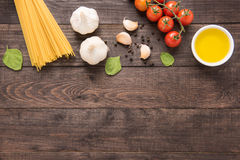 Pasta ingredients. tomato, garlic, pepper, oil and mushroom on w Royalty Free Stock Photo