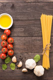 Pasta ingredients. tomato, garlic, pepper, and oil on wooden bac Stock Photo