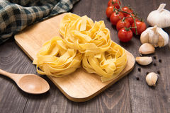 Pasta ingredients. tomato, garlic and pepper on wooden backgroun Royalty Free Stock Photo
