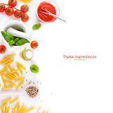 Pasta ingredients - tomatoes, olive oil, garlic, italian herbs, fresh basil and spaghetti on a white board background stock images
