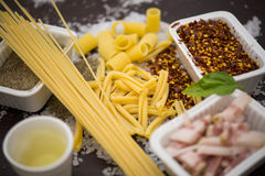 Pasta and ingredients typical of Italian cuisine Royalty Free Stock Image