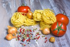 Pasta ingredients on wood background Stock Images