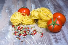 Pasta ingredients on wood background Royalty Free Stock Photos