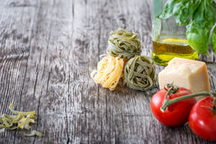 Pasta ingredients on a wooden table Royalty Free Stock Photo