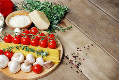 Pasta ingredients on the wooden table Royalty Free Stock Photo