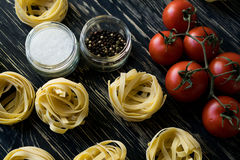 Pasta ingridients and spice on wooden surface. Pasta ingridients and spice on wooden background Stock Photo