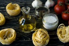 Pasta ingridients and spice on wooden surface. Stock Photography