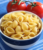 Pasta inside bowl. And tomato Stock Image