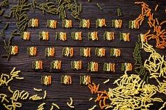 Pasta italian flag. Italian cooking. Pasta  in italian flag colors. Tricolori pasta fusili Royalty Free Stock Photo