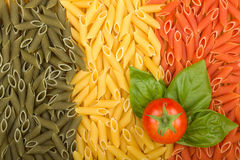 Pasta Italian flag with tomato and basil. Pasta Italian flag texture with tomato and basil Stock Photo