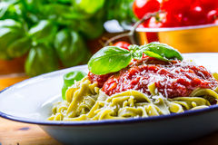 Pasta. Italian and Mediterranean cuisine. Pasta Fettuccine with tomato sauce basil leaves garlic and parmesan cheese. An old home. Kitchen with old kitchen Royalty Free Stock Image