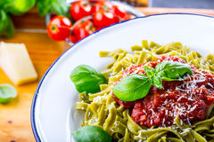 Pasta. Italian and Mediterranean cuisine. Pasta Fettuccine with tomato sauce basil leaves garlic and parmesan cheese. An old home. Kitchen with old kitchen Stock Photo