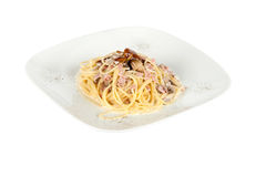 Pasta italiana con i funghi ed il prosciutto Fotografia Stock