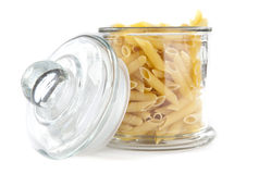 Pasta in a Jar. Yellow Pasta in a Glass Jar on White  Background Royalty Free Stock Photo
