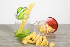 Pasta in a jar on a table royalty free stock photo