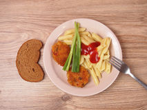 Pasta with ketchup. Chopped turkey cutlets in breadcrumbs Royalty Free Stock Photo