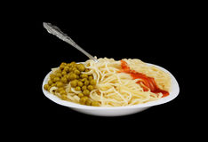 Pasta, ketchup and green peas with fork isolated Royalty Free Stock Photos