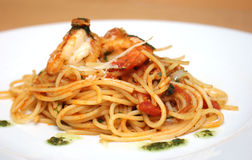 Pasta with king prawns. Fresh linguine with king prawns and a tomato and herb sauce Stock Images