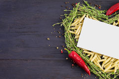 Pasta laid out in the shape of a heart and decorated with thyme Royalty Free Stock Images