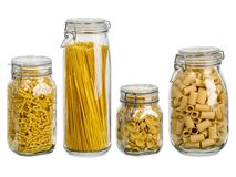 Pasta in large glass jars. Photo of different pasta types in large glass jars over white background Stock Images