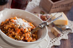 Pasta with lentils and vegetables. Pasta with lentils, vegetables and cheese, selective focus Royalty Free Stock Image