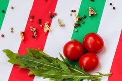 Pasta, letters, arugula, cherry , Italian tricolor Stock Images