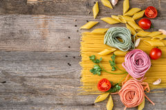 Pasta like flowers, space left for text, topview. Composition of pasta looking like flowers, additional space left for text on the side, topview stock photo