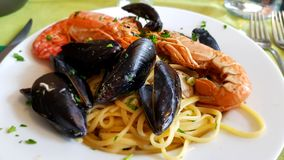 Pasta linguine with seafood. Italian cuisine royalty free stock images
