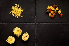 Pasta. Macaroni, Tagliatelle, trottole, tricolore royalty free stock photo